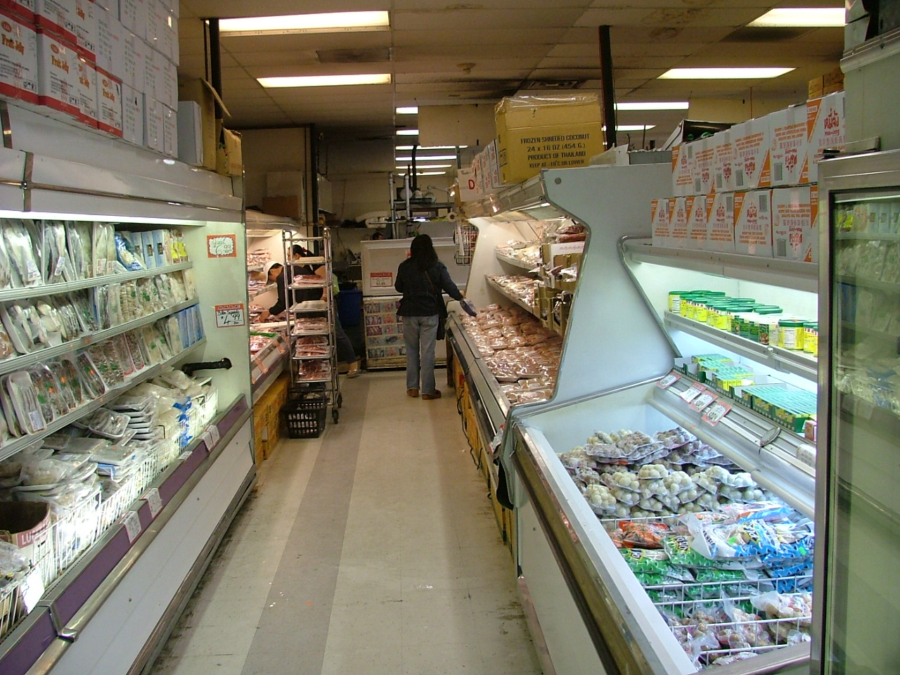 Fresh meats and vegggies in a typically clean aisle