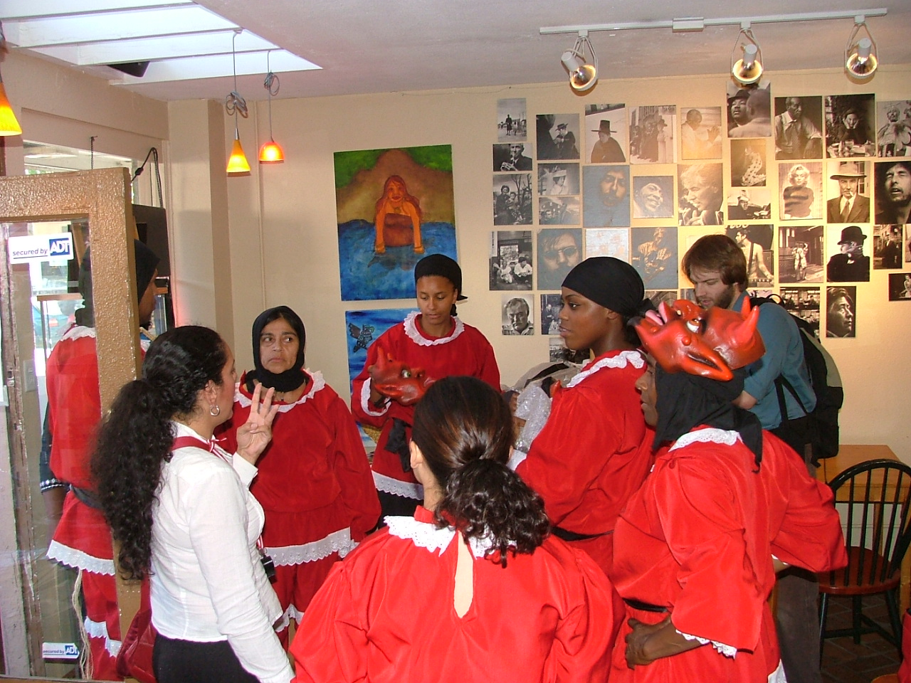 Choreographer instructs troupe before performance